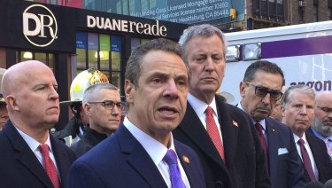 New York Governor Andrew Cuomo in the foreground.