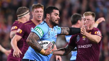 Andrew Fifita of the NSW Blues fends off Cameron Munster of the Queensland Maroons during State of Origin Game 3 between the Queensland Maroons