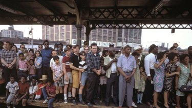 People jam a platform at a Philadelphia station as they wait for Bobby Kennedy's coffin to pass by on a train.