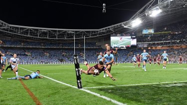 Dane Gagai flies over for a try for Queensland moments after being denied by the bunker.