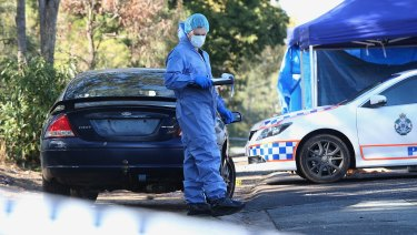 Police attend a crime scene where the man died from stab wounds at Murrumba Downs.
