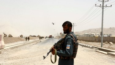 An Afghan policeman stands guard in Kandahar southern of Kabul, Afghanistan.