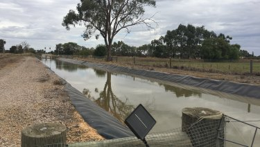 An irrigation canal with a solar-powered monitoring device, near Tatura in Victoria's Goulburn Valley.