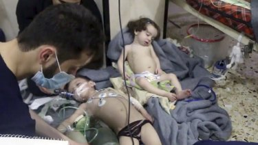 Medical workers treat toddlers following an alleged poison gas attack in the opposition-held town of Douma, in eastern Ghouta, near Damascus, Syria, on Sunday.