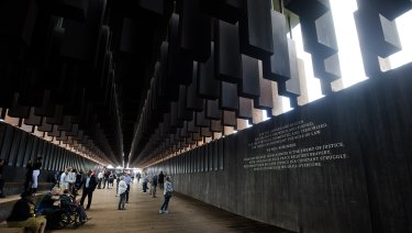 Visitors walk through the National Memorial for Peace and Justice in Montgomery, Alabama.