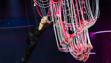 Pink swings from a chandelier at her first Australian concert in Perth.
