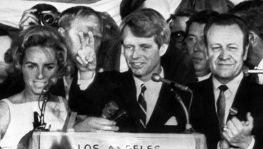 In this June 5, 1968 file photo, presidential hopeful Senator Robert F. Kennedy waves goodbye to his supporters as he prepares to leave the Ambassador Hotel ballroom in Los Angeles, before exiting through a kitchen backatage.