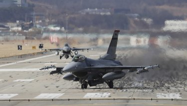 US Air Force F-16 fighter jets land at the Osan US Air Base in Pyeongtaek, South Korea, on Tuesday, March 20.