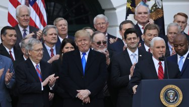 Mission accomplished: US President Donald Trump and Vice President Mike Pence during a passage of the tax bill event at the White House.