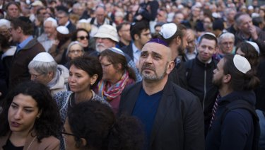 People wear Jewish skullcaps during a demonstration against anti-Semitism in Berlin.