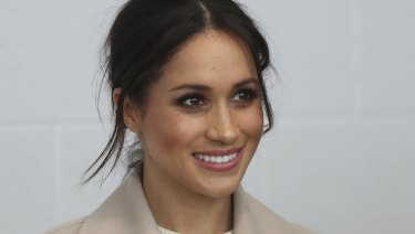 Meghan Markle  smiles during a visit with Prince Harry to the  Eikon Exhibition Centre in Lisburn, Northern Ireland.