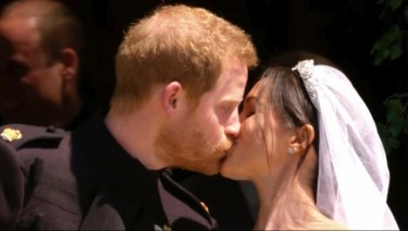 The moment the world was waiting for: Prince Harry and Meghan Markle kiss after their wedding at St George's Chapel in Windsor Castle.