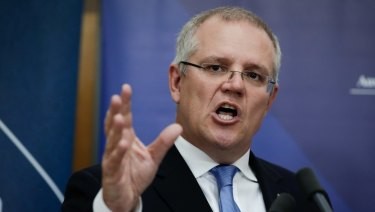 Treasurer Scott Morrison. In its mid-year budget update, the government revised down its expectations for wages growth.