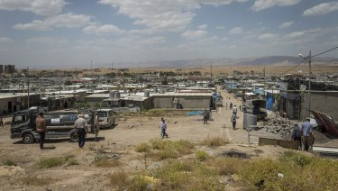 People walk in the Domiz camp for Syrian refugees, near the town of Dohuk, northern Kurdistan, Iraq.