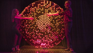 Designers Yvonne Chan and David Holden with their creation Midnight Sun featuring in Vivid 2018.