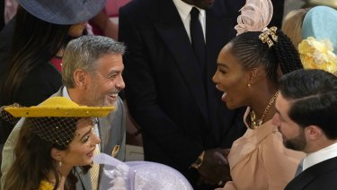 George and Amal Clooney greet Serena Williams and Alexis Ohanian before the wedding ceremony.