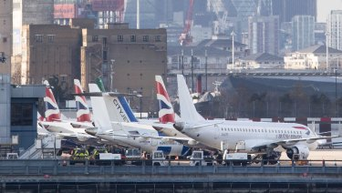 Passenger aircraft sit grounded on the tarmac at London City Airport, following the discovery of an unexploded bomb, in London, UK.