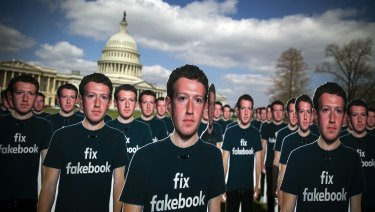 Cutouts of Facebook CEO Mark Zuckerberg are displayed on the South East lawn of the Capitol building ahead of testimony before a joint hearing of the Senate Judiciary and Commerce Committees in Washington, DC.