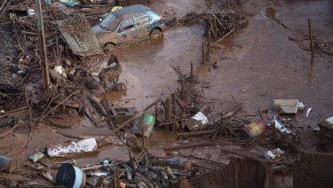 Horses struggle in the mud in the small town of Bento Rodrigues, Minas Gerais, Brazil after the Samarco dam burst on November 6, 2015.