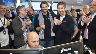 Mike Cannon-Brookes (left, with scarf) and Scott Farquhar watch as Atlassian's shares open on the Nasdaq.