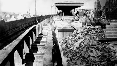 The Milsons Point tram station is demolished by workmen on 10 July 1958.