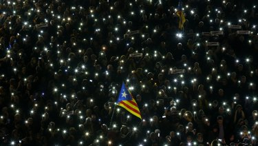 Demonstrators gather during a protest in support of Catalan politicians imprisoned at the Sant Jaume square in Barcelona, Spain.
