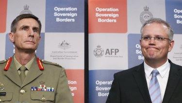 'On-water' matters: General Campbell alongside former immigration minister Scott Morrison in 2014.