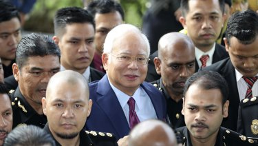 Former Malaysian Prime Minister Najib Razak, centre, arrives at a court house in Kuala Lumpur on Wednesday.