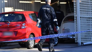 Homicide squad detectives and forensic scientists at the property on Thursday.