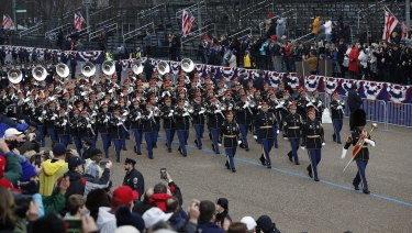 Military units march during the 58th Presidential Inauguration parade for President Donald Trump in Washington.