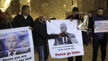 Palestinians hold posters of US Vice-President Mike Pence as they protest against his visit to Israel.