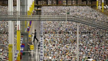 Workers gather items for delivery from the warehouse floor at Amazon's distribution centre in Phoenix, Arizona.