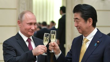 Russian President Vladimir Putin, left, and Japanese Prime Minister Shinzo Abe, toast after an opening ceremony of the cross-cultural year of Russia and Japan at the Bolshoi Theater in Moscow, Russia last week.