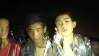 Some of the trapped boys praying in the cave in Tham Luang.