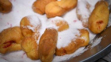 Doughnuts in sugar at American Doughnut Kitchen.