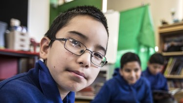 Areyan Akbari, 11, works with his classmates brain storming ideas at Merrylands East Primary School, which partners with Atlassian and the Museum of Contemporary Art to give kids a real taste of the world of work.