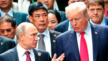 Masters of misinformation: US President Donald Trump, right, and his Russian counterpart Vladimir Putin at the APEC summit in Vietnam in November.