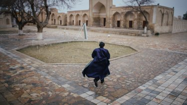 A man runs at Chor Bakr, near Bukhara, Uzbekistan. Bucking a global trend, Uzbekistan's new leader is reining in the secret police, releasing political prisoners and allowing some freedom of expression.