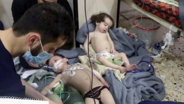 Medical workers treat toddlers following an alleged poison gas attack in Douma, near Damascus, on April 8.