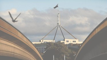 Parliament House, as seen through the centre of Commonwealth Bridge.