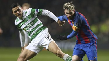 Rogic takes on Barcelona star Lionel Messi in the Champions League.