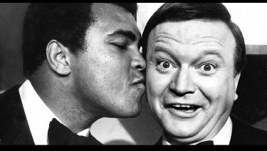 """Muhammad Ali forgives Bert Newton for his """"I like the boy"""" gaff with an after show kiss on the cheek at the 1979 Logies."""