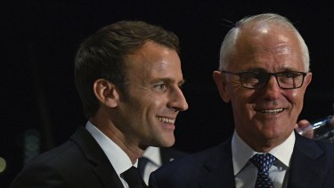 Missing out: President of France, Emmanuel Macron, left, and Prime Minister Malcolm Turnbull won't have Victorian officials on their guest list at a Sydney signing.