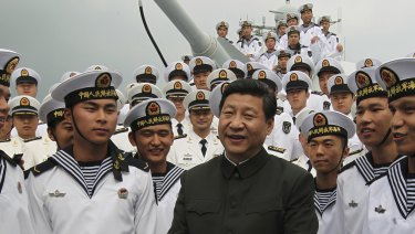 Xi Jinping, centre, talks to sailors onboard the Haikou navy destroyer during his inspection of the Guangzhou military theatre of operations of the People's Liberation Army in Guangzhou, China.