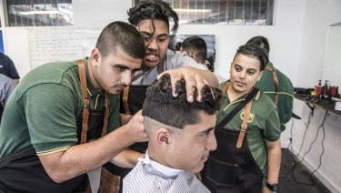 Rabin Elkheir gets an urban fade cut courtesy of fellow students at Granville Boys High's new barber shop.