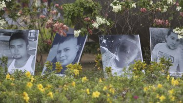 Photos of people killed in protests are displayed in a roundabout in Managua.