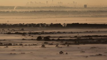Fog and smog across the Sydney Basin on the coldest morning of the year so far.