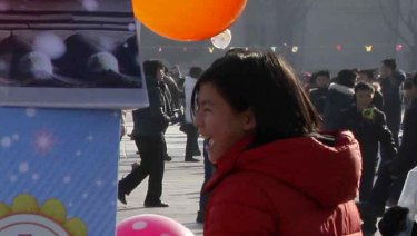 North Koreans play on Kim Il-sung Square on New Year's Day.