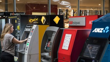 Banks may start to remove under-used ATMs, the Reserve Bank says.