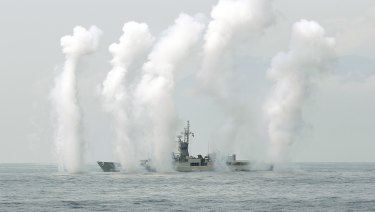 A Taiwan Navy's Knox-class frigate fires chaff during a navy exercise in the bound of Suao naval station in Yilan County, northeast of Taiwan.
